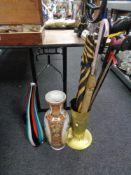 An embossed brass stick pot, ceramic vase, glass art vase,