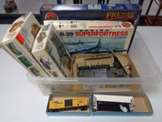 A box of model making kits, military vehicles,