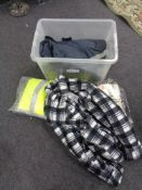 A crate of new and un-used clothing, thermal outdoor trousers,