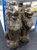 A pair of gilded concrete lion figures