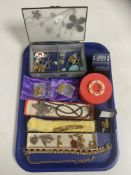 A tray of assorted costume jewellery, 9ct gold rope chain, gold earring, silver brooch,