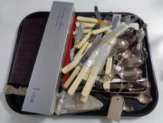 A tray of assorted flatware, butter knives, cake servers, plated and silver teaspoons,