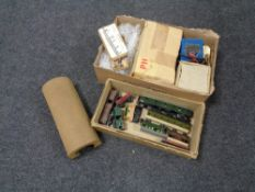 Two boxes of Marklin tin plated rolling stock and track,