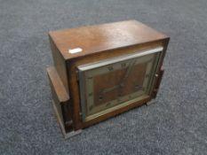 An oak cased Art Deco Coronet mantel clock