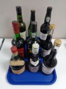 A tray containing nine bottles of alcohol to include port, sherry,