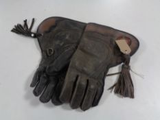 A pair of vintage leather falconry gauntlets