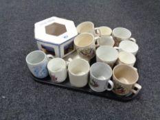 A tray of china, commemorative beakers,