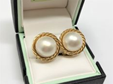 A pair of 18ct gold mabe pearl earrings.
