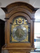 A continental scumbled-cased longcase clock, dial signed Hans Nielson, with pendulum and weights.