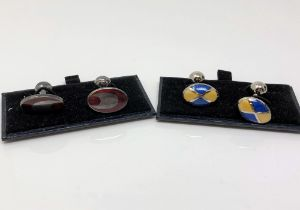 Two pairs of silver and enamelled cuff links