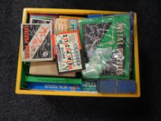 A basket containing vintage and later metal puzzles.