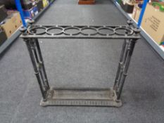A 19th century cast iron Coalbrookdale stick stand with lift out tray,