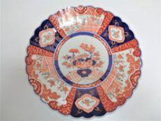 A 19th century Japanese Imari scalloped edged plate.