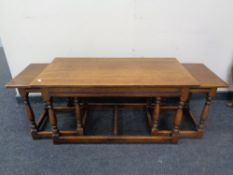 An oak coffee table fitted two beneath.