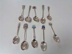 Ten silver crested teaspoons.