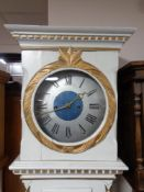 A continental painted cased longcase clock with metal dial, pendulum, no weights.