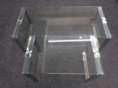 Two contemporary glass topped coffee tables on metal legs.