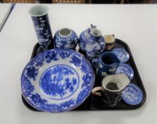 A tray of assorted china, character jugs, Willow pattern pin dishes,