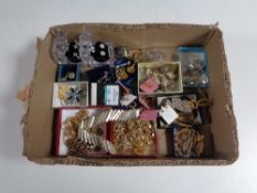 A box containing a quantity of assorted costume jewellery to include earrings, necklaces,