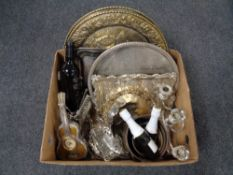 A box containing assorted plated wares, pair of brass embossed wall plaques, bottles of Asti,