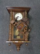 An antique Vienna wall clock with brass and enameled dial.