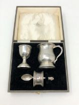 A boxed silver Christening set