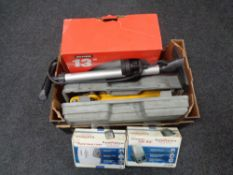 A box containing car accessory kits, cased trolley jack, 13 inch wheel trims, etc.