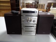 A Technics four piece midi Hi-Fi separates system with speakers and remote.