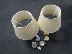 A tray containing a pair of brass table lamps with shades, a Lladro figure,