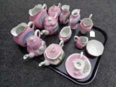 A tray containing antique pink lustre tourist china to include vases, teapots,