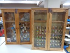 Two pine double door glazed wall cabinets containing sewing threads.