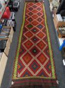 A Suzni kilim runner 318 cm x 84 cm