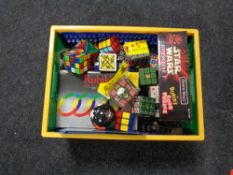 A box containing a quantity of Rubiks cubes and puzzles.