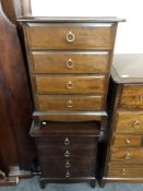 A pair of Stag Minstrel four drawer bedside chests.