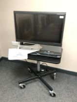 An Optelec ClearView C HD 24'' Speech TFT Video Magnifier on height adjustable trolley,