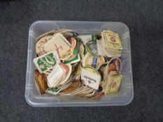 A box containing a large quantity of assorted beer mats.
