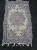 A fringed chain stitch rug,