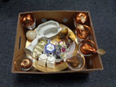 A box containing contemporary wine glasses, glass fruit bow with artificial fruit,