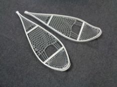 A pair of snow shoes.