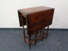 A Victorian style drop leaf table.