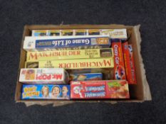 A box containing vintage games to include Tomy, Screwball, Scramble, Game of Life,
