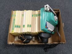 A box containing children's encyclopedias, a toy typewriter together with two vintage cameras.