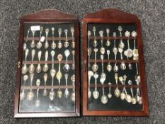 Two spoon display cases containing a quantity of continental silver and plated teaspoons.