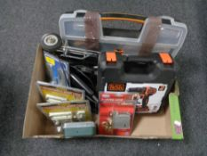 A box containing cased Black and Decker drill, Black and Decker jigsaw, nail door locks,