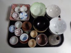 A tray containing oriental china and pottery, finger bowls, rice bowls, vases etc.
