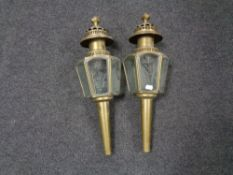 A pair of early 20th century brass Coach lamps with etched glass panels.
