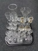 A tray containing assorted glassware to include silver plated glass stemmed candlesticks, vases,