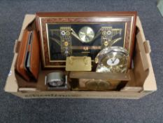 A box containing assorted mid 20th century and later mantel and wall clocks together with a leather