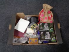 A box containing costume jewellery, solar string lights, etc.