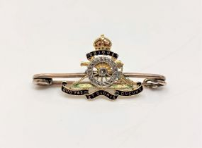 A gold diamond set Royal Artillery brooch CONDITION REPORT: 3.